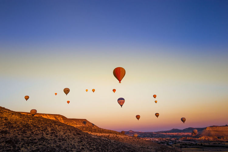Colorful hot air balloons flying over the valley at Cappadocia,Anatolia,Turkey.NEVSEHIR/TURKEY- JULY 23,2016 Adventure Anatolia Attraction Background Capadocia Cappadocia Chimney Cliffs Conical Destination Famous Fly Flying Geological Hill Hot Kapadokya Landmark Landscape Limestone National Nature Nevsehir Outdoor Park Rock Spectacular Summer Sunlight Sunrise Sunshine Tourism Travel Turkey Turkish Vacation Valley Volcanic  The Great Outdoors - 2019 EyeEm Awards No People Sky