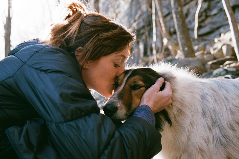 Pure love Love Togetherness Bonding Eyes Closed  Young Adult Outdoors Real People Care Pets Nature 35mm Film Analogue Photography Film Film Photography