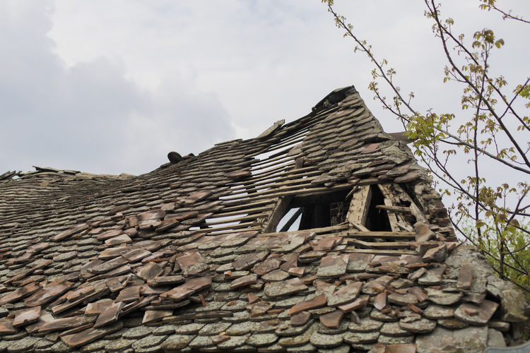old house roof devastated by earthquake House Roof Old Devastated Ruined Ruin Earthquake Consequence Gap Aftermath Day Damaged Collapse Structure Waste Destruction Aged Construction Effect Catastrophe Ravages Devastation Demolition Destroyed Aftereffect Shabby Neglected Dangerous Abandoned Deserted War Architecture Ancient Rural Lathing Sky Rustic Weathered Dilapidated Rafter Vintage Farm Wooden Empty Countryside Wreck Debris Building Shack Damage