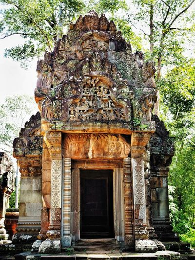 Temple at Angkor Archaeological Park Cambodia Khmer Architecture Khmer Temple Temple Angkor Angkor Thom Architecture Built Structure Entrance Day Building Exterior Sculpture Statue History Ancient Place Of Worship No People Spirituality Old Ruin Religion Ancient Civilization