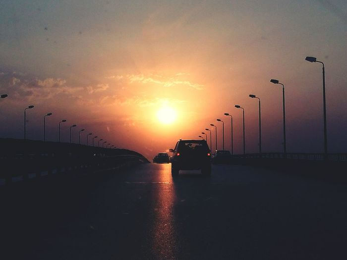 Sunset Car Transportation Road Reflection No People Sky Business Outdoors Business Finance And Industry Road_to_sun Egypt Huwawei_y6_pro Cloud - Sky Architecture Bride Nature Day City_gates