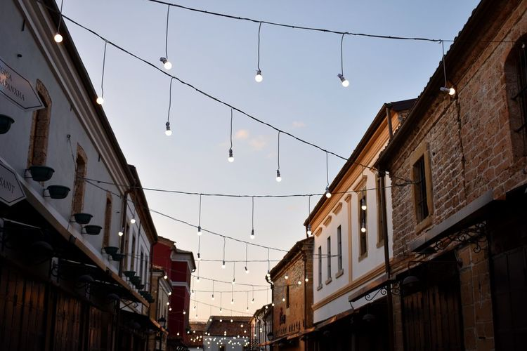 cute lights Low Angle View Blue Blue Sky Cityscape Date Light And Shadow Backgrounds Bulbs Light Bulb Small Town Stories Small Cities Korçë, Albania Vintage Building Sunset Travel Cute Lights Calm City Sky Architecture Building Exterior Built Structure Tree Topper The Still Life Photographer - 2018 EyeEm Awards The Photojournalist - 2018 EyeEm Awards The Great Outdoors - 2018 EyeEm Awards The Street Photographer - 2018 EyeEm Awards The Traveler - 2018 EyeEm Awards