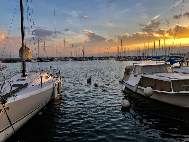 Water Nautical Vessel Transportation Sky Mode Of Transportation Sunset Sea Nature Cloud - Sky Waterfront Moored Scenics - Nature Outdoors Reflection Tranquility Beauty In Nature Real People Men Sailboat Travel