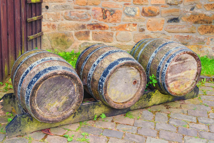 Oak barrel or wine barrel used to store beer and wine in a brewery. Abandoned Architecture Barrel Brick Brick Wall Built Structure Container Cylinder Day Focus On Foreground Metal No People Obsolete Old Outdoors Rusty Still Life Wall Wall - Building Feature Weathered Wine Cask Winemaking