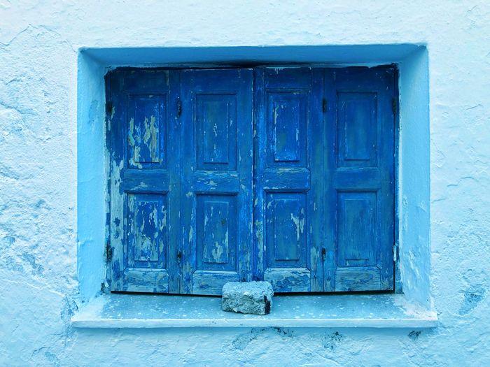 Closed blue door of building