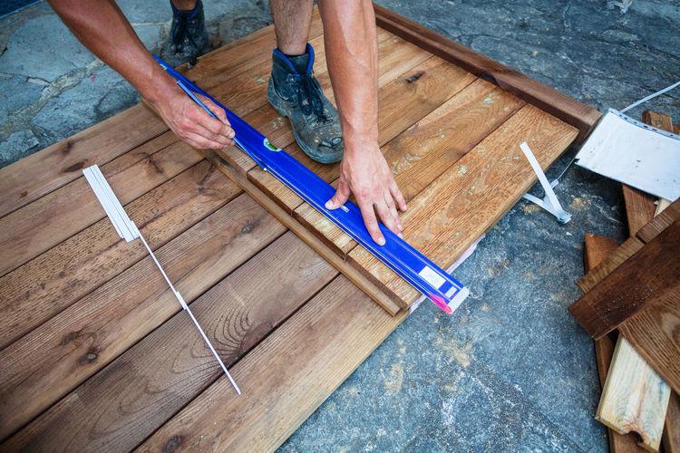 Low Section Of Carpenter Making Furniture