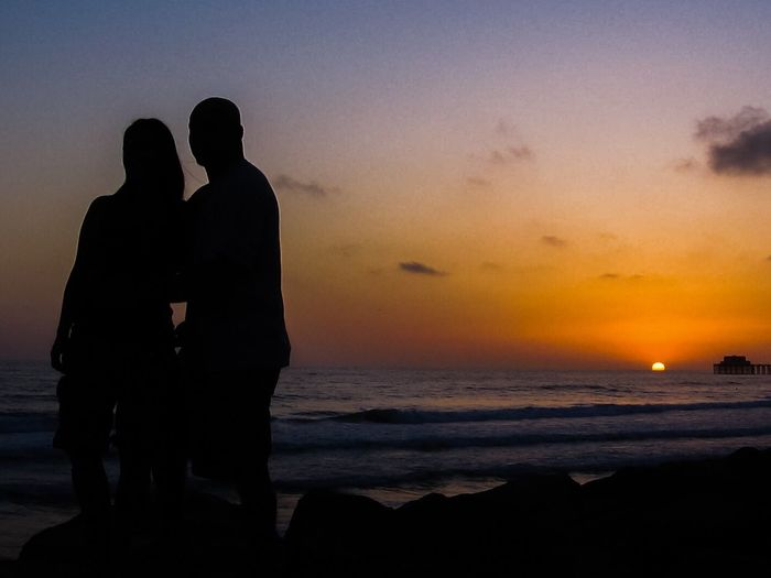 Live For The Story Silhouette Sunset Love Togetherness Sea Two People Real People Sky Beauty In Nature Scenics Water Beach Outdoors Vacations Shore
