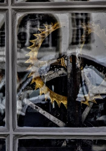 The gears Close-up Window No People Full Frame Outdoors Day Conceptual Gear Mechanic Mechanical Mechanism Mechanical Things Gear Wheel Machinery Machine Part Paint The Town Yellow