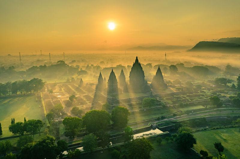 Prambanan temple yogyakarta indonesia panoramic view of buildings in city during sunset