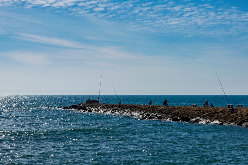 Fishing on the pier Sea Water Horizon Over Water Horizon Sky Beauty In Nature Waterfront Day Tranquil Scene Tranquility Cloud - Sky Fishing Fishing Rod Nature Groyne Non-urban Scene Outdoors SPAIN
