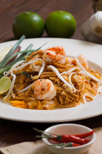 High angle view of pad thai in plate on table