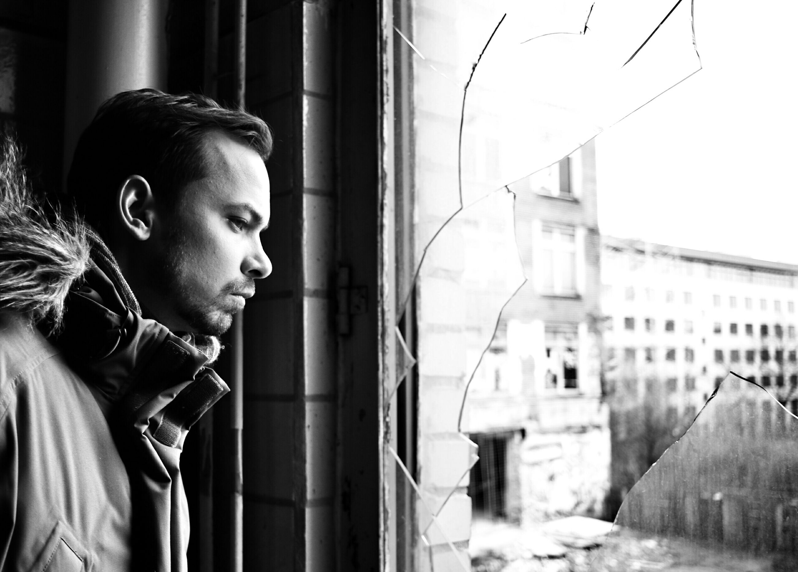 architecture, built structure, building exterior, window, young adult, lifestyles, indoors, person, day, young men, building, human representation, art, leisure activity, headshot, front view, focus on foreground, side view