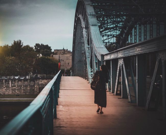 Built Structure Architecture Bridge - Man Made Structure Rear View Full Length Real People Day Women Lifestyles One Person Leisure Activity Outdoors Tree Sky Building Exterior Adult People Krakow The Week On Eyem EyeEm Best Edits EyeEm Selects EyeEm Gallery Poland Streetphotography Street