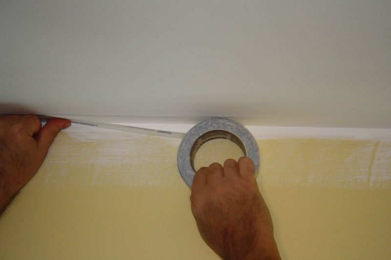 mans hands putting tape on ceiling to paint the wall Close-up Cropped Decorator Focus On Foreground Human Finger Leisure Activity Lifestyles Men At Work  One Woman Only Painter Painting Part Of Person Personal Perspective Tape Unrecognizable Person Working Hands Workman