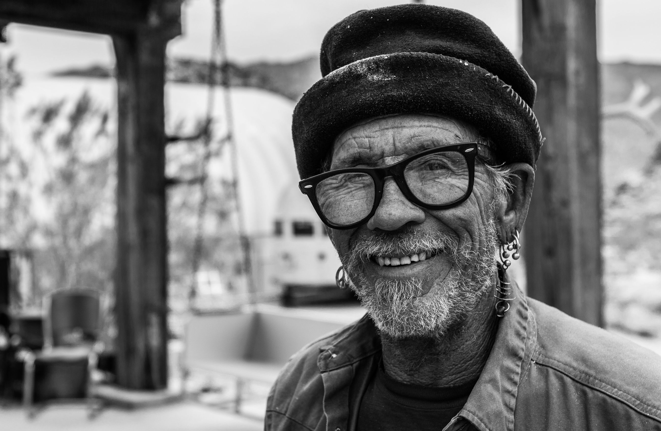 one person, focus on foreground, real people, lifestyles, front view, one man only, headshot, looking at camera, beard, portrait, leisure activity, eyeglasses, adults only, close-up, only men, adult, day, men, people, outdoors, senior men, human body part, young adult