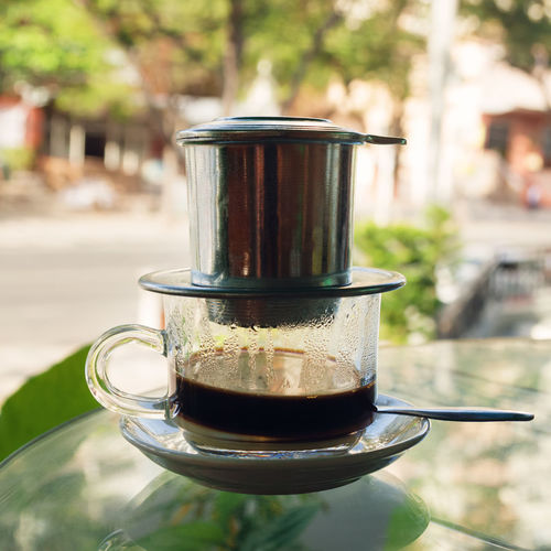 Drip Black Coffee in Vietnamese style with condensed milk on a glass method of making coffee. ASIA Beverage Coffee Time Condensed Milk EyeEmNewHere Lifestyle Morning Black Coffee Brewing Cafe Close-up Coffee Coffee - Drink Coffee Cup Cup Day Drink Energy Food And Drink Mug Outdoors Still Life Street Traditional Vietnamese Coffee