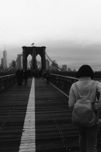 Brooklyn Bridge, 2018 Built Structure Architecture Rear View Real People Sky Bridge Connection Travel Destinations Bridge - Man Made Structure Standing Tourism Travel City Transportation Leisure Activity Lifestyles One Person Suspension Bridge Women Outdoors Warm Clothing Brooklyn Bridge  New York New York City Black And White My Best Photo The Art Of Street Photography