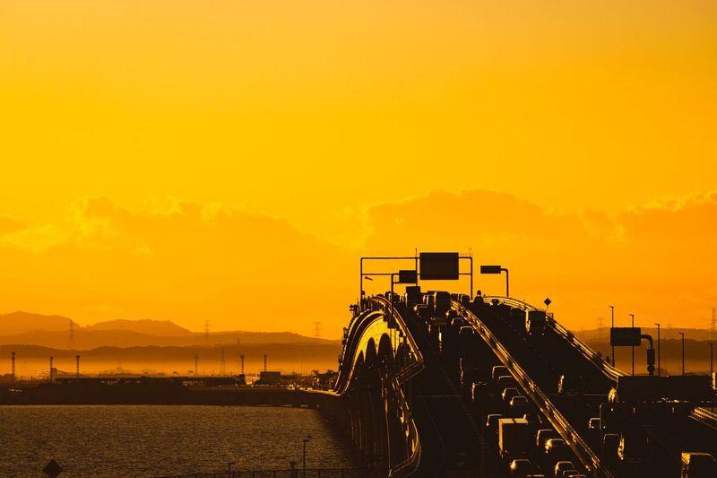Cars On Bridge Against Sky During Sunset