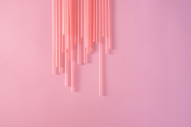 Drinking straws on bright pink background, top view Pink Color Indoors  No People Close-up Still Life Directly Above Studio Shot White Color Large Group Of Objects Art And Craft High Angle View Creativity Copy Space Craft Arrangement Pattern Purple Order Man Made Man Made Object Plastic Pollution