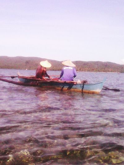 Fishing Water Fishermen's Life Boats And Sea Clear Sea Northern Samar Home Sweet Home Outdoors sitting hat two men sunny Nature_collection Eyeem Philippines Day Sunny Beauty In Nature Sky Real People Sea Men EyeEmNewHere