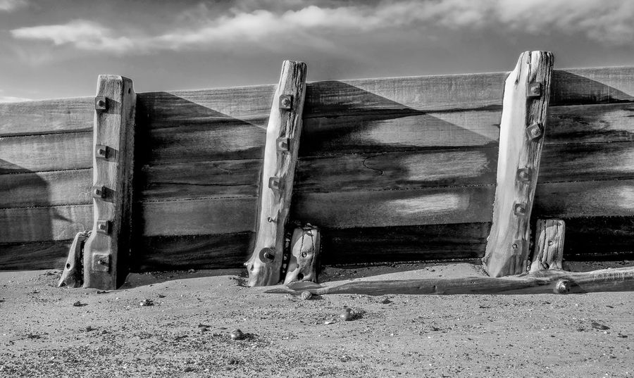 3 Post Weathered Balck And White Cloud - Sky Day Groyne Nature No People Outdoors Sand Sea Break Sea Defence Sea Defences Sea Groynes Sky Weathered And Torn Weathered Metal Weathered Wall Weathered Wood Wood - Material