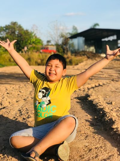 Arms Raised Human Arm Limb Childhood Human Body Part Smiling Happiness Outdoors Playing Day Fun One Person Child Cheerful
