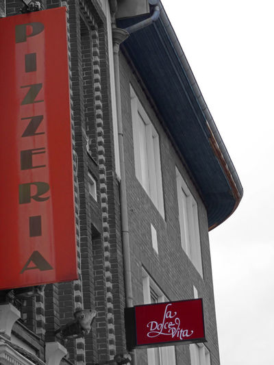 Rusty with effect front of French Italian restaurant and his angle - 2019 Rusty Front Pizzeria Restaurant Retro Sign In Front Facade Detail Facadelovers Bricks Red Color Red Old Half BnW La Dolce Vita Edited Architecture Information Sign Signs Sign Collection Low Angle View Close-up