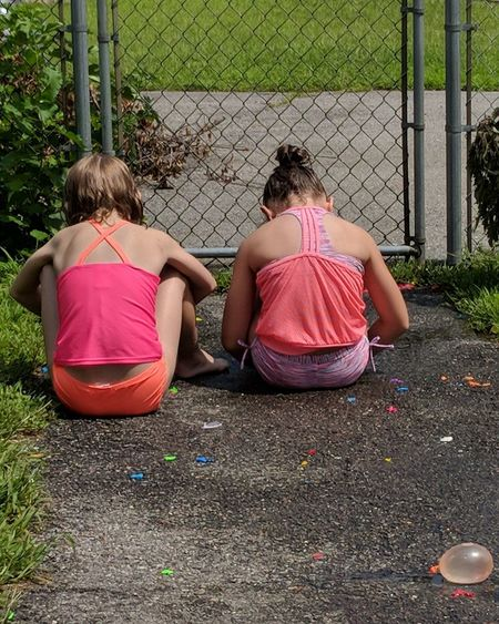 Friendship Togetherness Sitting Girls Child Full Length Rear View Back Human Back Chainlink Fence Fence