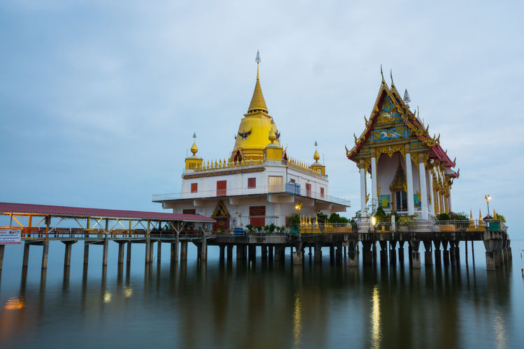 Wat Hong Thong Architecture Built Structure Day Gold Colored Nature No People Outdoors Place Of Worship Religion Sky Spirituality Water
