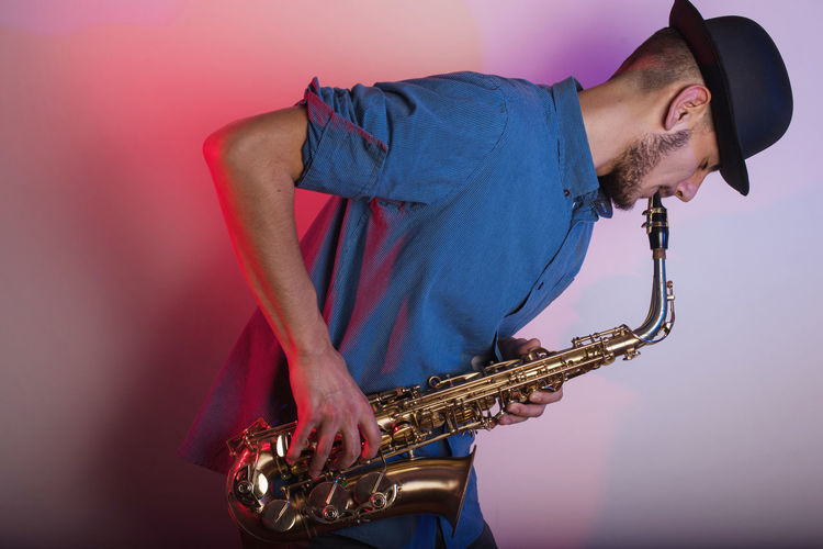 Close-Up Of Man Playing Saxophone