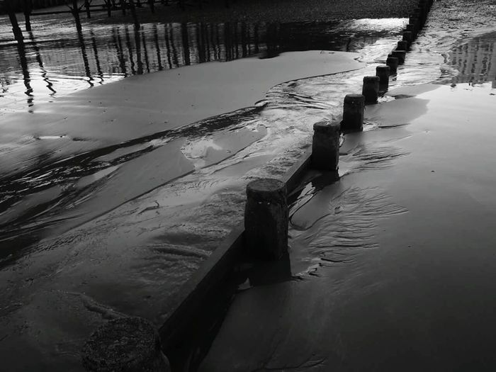 Black and white beach. EyeEmNewHere Blackandwhite Photography Blackandwhitephoto Black & White Greyscale Beachphotography Waves, Ocean, Nature Movement Photography Rivers And Streams Wetsand Groins English Beach Pier Water Lake Flood Reflection Sky Landscape