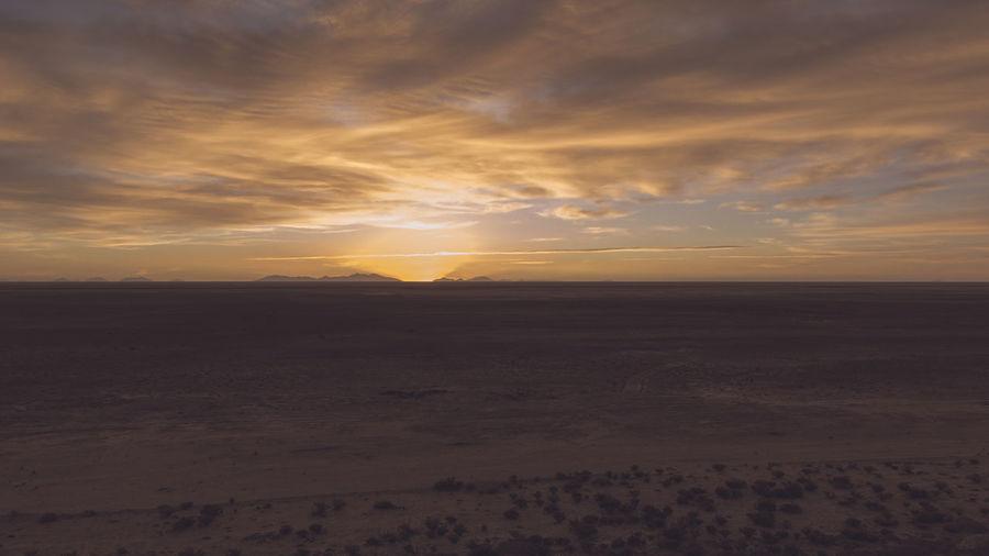 Hotel De Sal Luna Salada - Overlooking The Bolivian Salt Flats at Sunset Atmosphere Atmospheric Mood Beach Beauty In Nature Calm Cloud Cloud - Sky Dramatic Sky Horizon Over Land Idyllic Landscape Majestic Moody Sky Nature Non-urban Scene Outdoors Remote Scenics Sea Sky Solitude Sun Sunset Tranquil Scene Tranquility