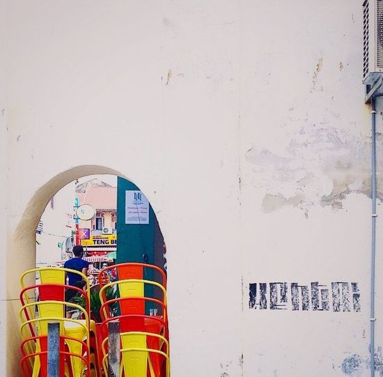 Colour Pop Stacked Chairs Archway White Wall Red Yellow Streetphotography My Unique Style Penang Malaysia Chipped Paint