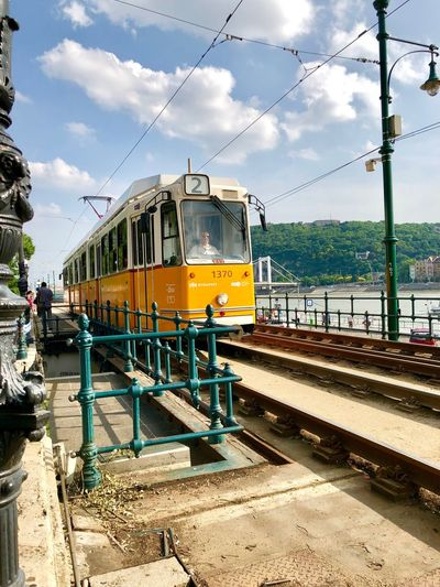 On my way with the Budapest tram along the Danube river Yellow Is The New Black Yellow Taxi Hungary Budapest Streetphotography Riverside Danube Budapest Tram Cable Car Transportation Mode Of Transportation Rail Transportation Sky Train Public Transportation Train - Vehicle Track Cable