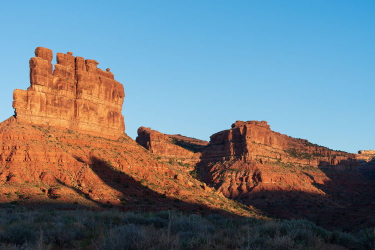 Landscape of red buttes against blue sky in the valley of the gods in utah