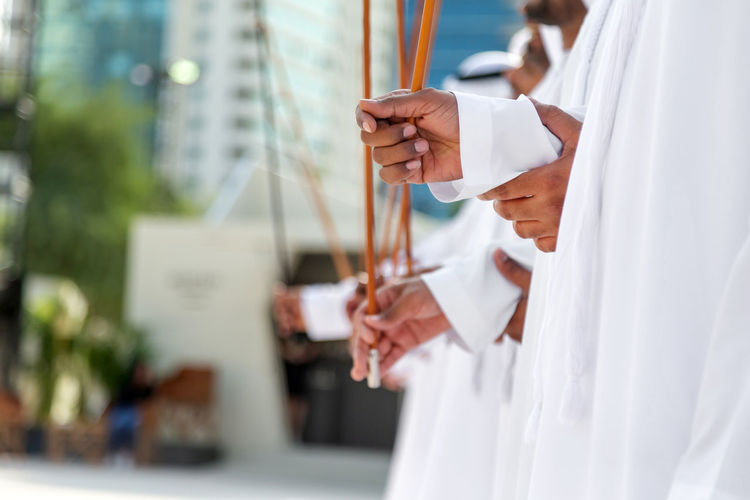 Traditional emirati al ayalah male dance, uae heritage, hands in frame