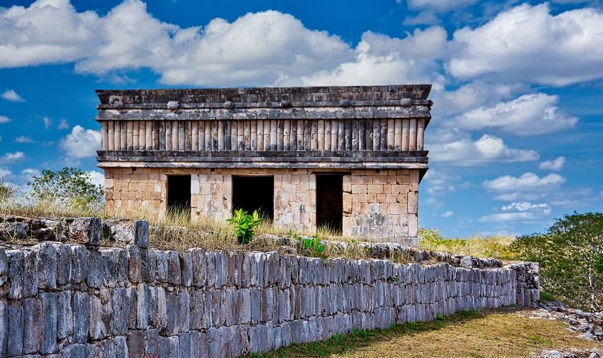 Uxmal, Mexico Ancient Civilization Architecture Building Building Exterior Built Structure Cloud - Sky Day History Nature No People Old Old Ruin Outdoors Plant Ruined Sky Stone Wall The Past Wall Wall - Building Feature Weathered This Is Latin America