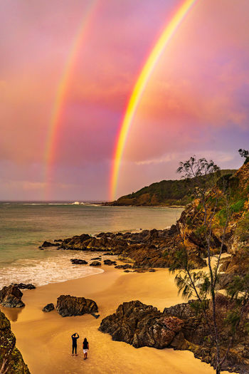 A beautiful double rainbow as the sunsets, lasting only a few moments. Beauty In Nature Scenics - Nature Sky Water Rainbow Sea Tranquility Sunset Land Nature Cloud - Sky Multi Colored Tranquil Scene Beach Idyllic Rock - Object Non-urban Scene Horizon Over Water Double Rainbow Outdoors Headland Colorful Scenic