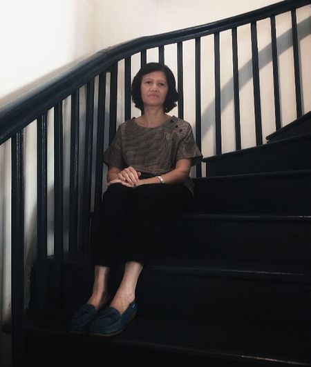 Sitting One Person Full Length Front View Indoors  Adult The Portraitist - 2019 EyeEm Awards Staircase Women Railing Portrait Architecture Casual Clothing Real People Looking At Camera Steps And Staircases Females Hairstyle