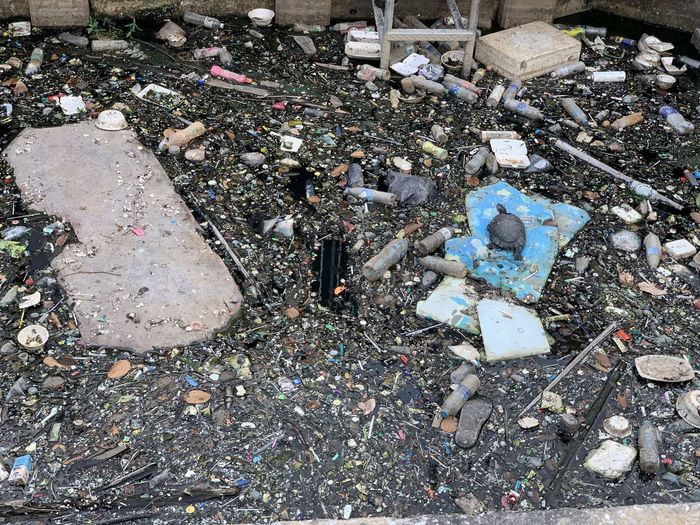 High angle view of garbage in bottle