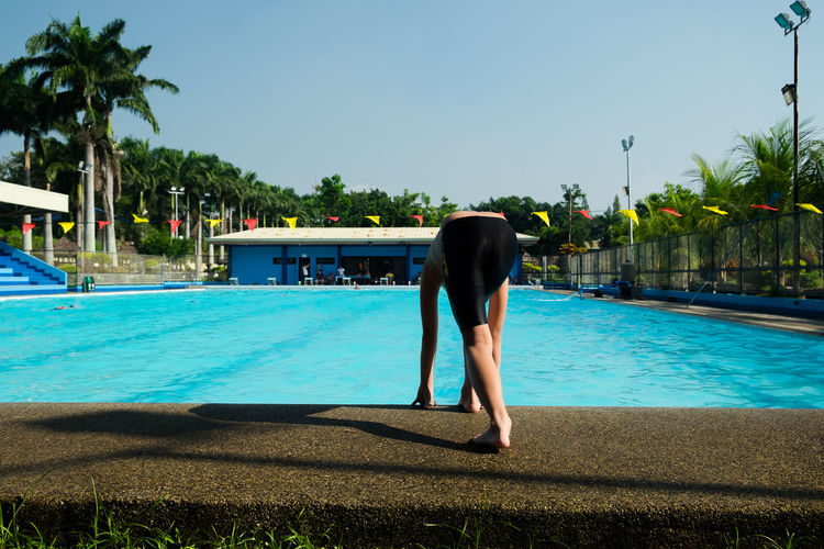 Swimming Pool Palm Tree Water One Man Only Only Men Adult Tree One Person Adults Only People Day Men Outdoors One Young Man Only Real People Full Length Sky Domestic Animals Mammal Young Adult Eyeem Philippines EyeEm New Here