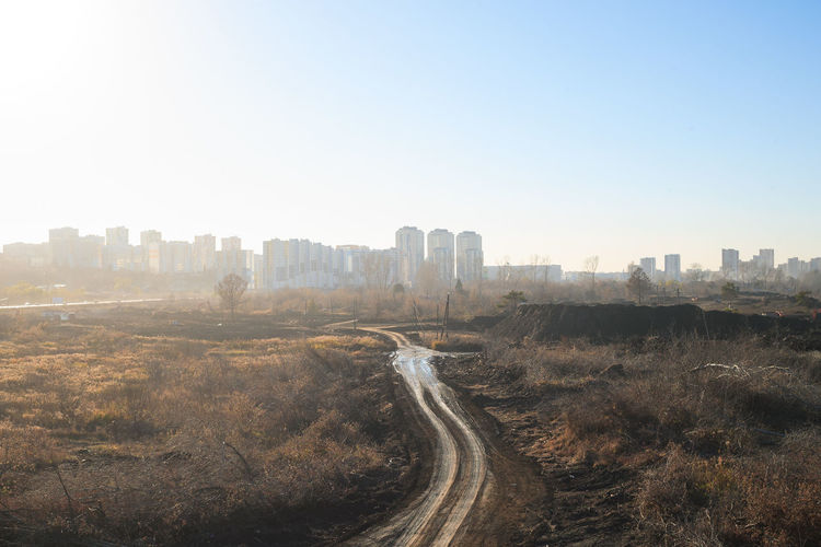 Landscape is under construction City Sky Landscape Clear Sky Cityscape Day No People Sunlight Outdoors Road Urban Skyline Siberia, Russia Country Road Path City Outskirts Skyline Autumn