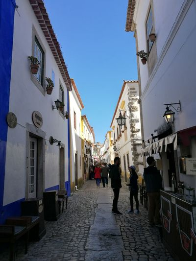 Architecture Travel Destinations Store Building Exterior Women City People Adult Sky Adults Only Outdoors Day Blues Garri❌ Portugal Obidos Portugal