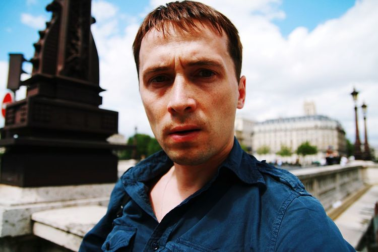 Portrait of man against sky