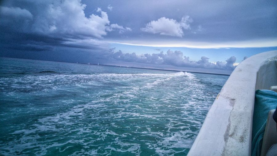 Speedboat trail Nature Cloud - Sky Sky Beauty In Nature Scenics Outdoors Water Cold Temperature Day Sea Landscape Tropical Island Life Scenic View Tranquil Scene Explore Escape Photography Stock Photo Speed Boat Ripples In The Water Boat Trail Boats And Water