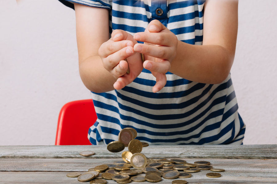 Boy dropping money on table Falling Hands Rich Boy Cash Childhood Close-up Coin Day Dropping Holding Human Hand Indoors  Money One Person People Playing Real People