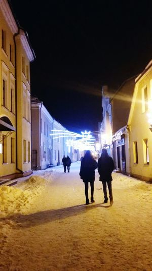 Couple Man And Woman Street Old Town Kedainiai Old Town City Men Full Length Winter Illuminated Warm Clothing Silhouette Architecture Building Exterior Built Structure Christmas Lights Christmas