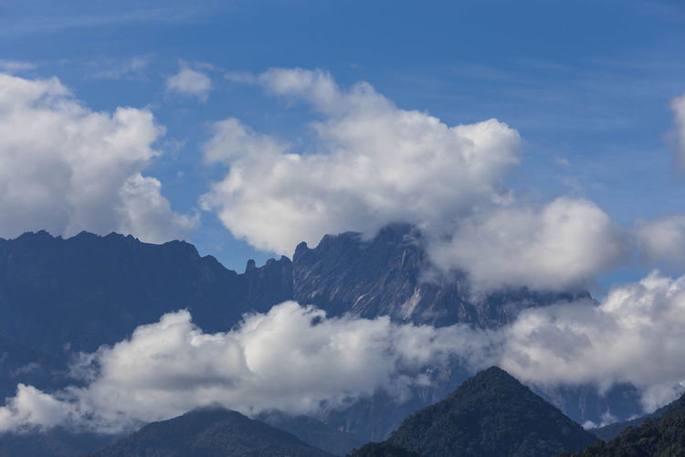 Clouds formation over peak of Mt. Kinabalu. Tranquility Nature No People Non-urban Scene Environment Cloud - Sky Mountain Sky Beauty In Nature Scenics - Nature Mountain Range Tranquil Scene Outdoors Day Landscape Idyllic Majestic Tourism Physical Geography Travel Mountain Peak Range Mt. Kinabalu Sabah Malaysia Kota Belud
