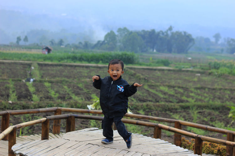 little boy dancing One Person Males  Child Real People Looking At Camera Standing Childhood Men Full Length Nature Boys Front View Portrait Wood - Material Day Lifestyles Landscape Leisure Activity Outdoors Innocence Human Arm EyeEmNewHere Moments Of Happiness