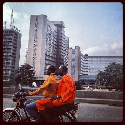 Okada ride Lagos Okada Nigeria Nigerians orange urban city africa african snapitoga streetphotography